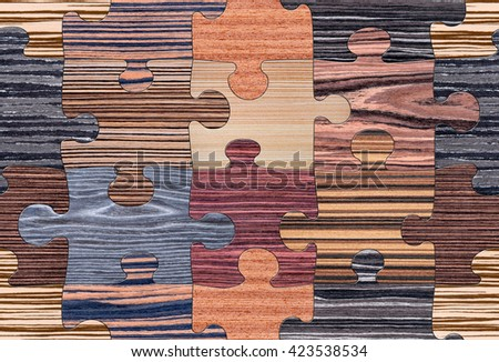 Wooden puzzles assembled for seamless background pattern. Will tile endlessly. - stock photo