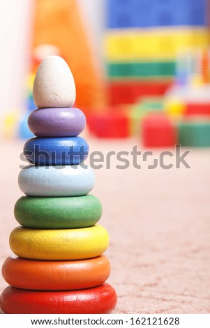 wooden pyramidion in room for children - stock photo