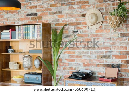 Wooden rack at the brick wall background