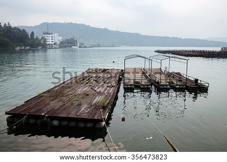 wooden raft and some boats in Sun Moon Lake Taiwan