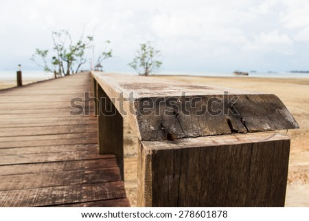 wooden railing on wood bridge,thailand - stock photo