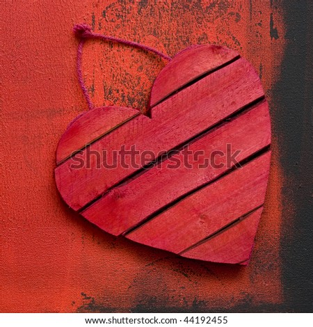 wooden red heart on painted background, artwork is created and painted by myself