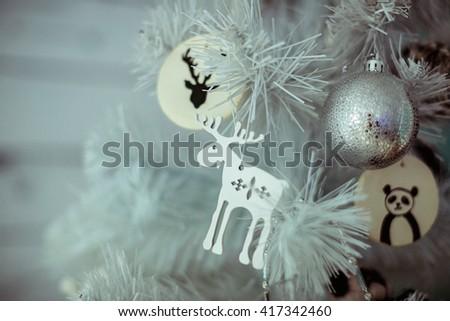Wooden reindeer on Christmas tree - stock photo