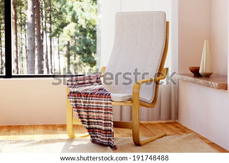 Wooden relaxing chair with rocking function in bedroom interior. - stock photo