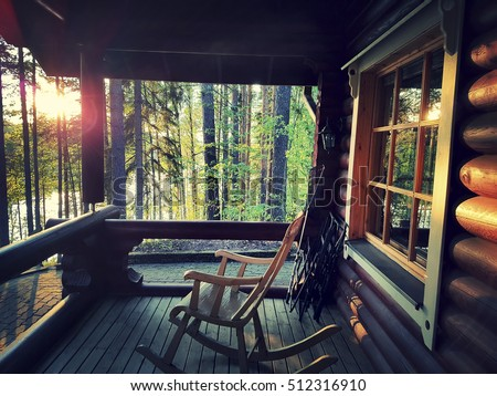 Wooden Rocking Chair On Front Porch