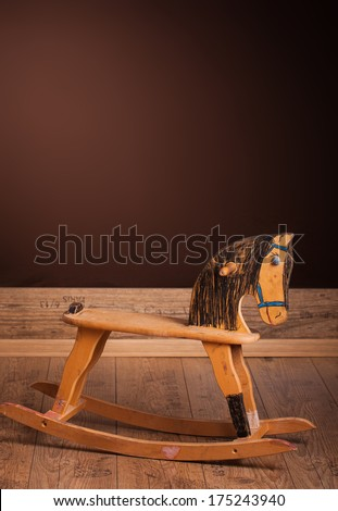 Wooden rocking horse hand colored by children. - stock photo