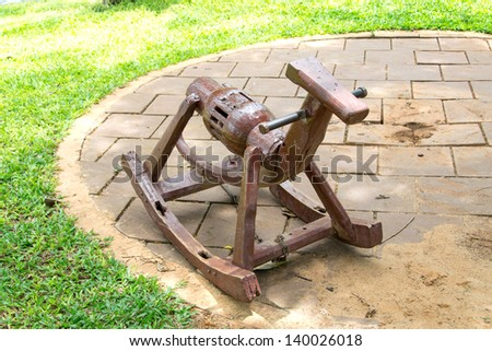 Wooden Rocking Horse in playground - stock photo