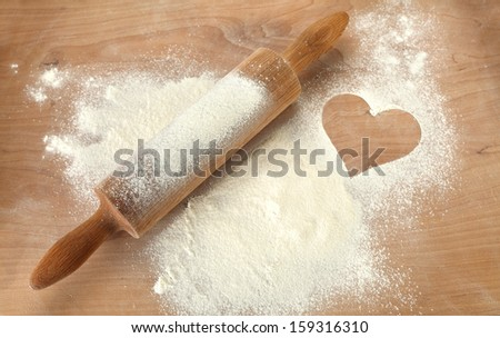 wooden roller and heart  - stock photo
