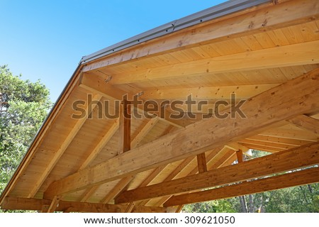 wooden roof construction of outdoor carport - stock photo