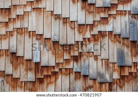 Wooden roof texture. Brown wooden tile background.