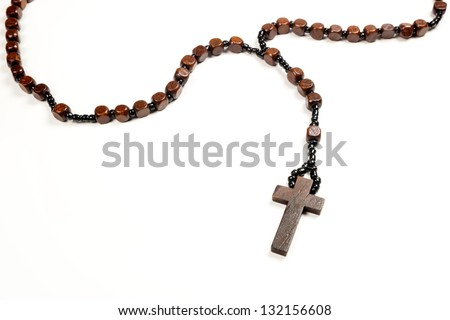 Wooden rosary beads and cross isolated on a white background.