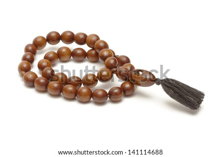 Wooden rosary on white background - stock photo