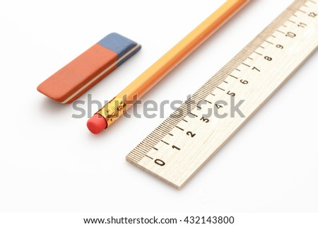 wooden ruler a simple pencil and eraser on a white background - stock photo