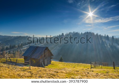 Wooden rustic house on a mountain hill of Ukrainian Carpathians. Spring time.  - stock photo