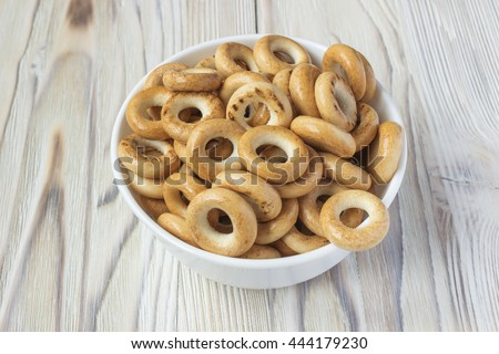 Wooden rustic table with national russian bagels. A group of bagels on a wooden table, top view - stock photo
