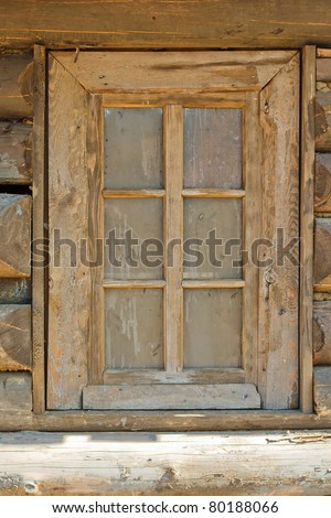 Wooden rustic window of an old wooden cottage. - stock photo
