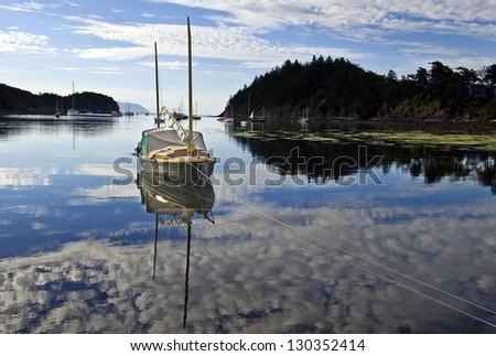 Wooden Sailboat moored at Fossil Bay \ Fossil Bay Sailboat - stock photo