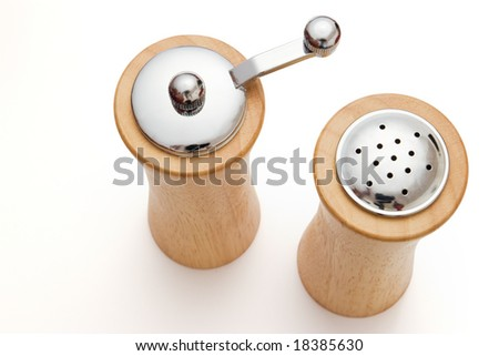 wooden salt and pepper shaker on white - stock photo