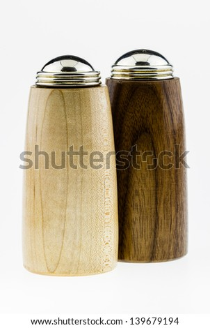 Wooden salt and pepper shakers on a white background. - stock photo