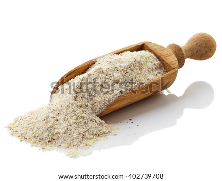 Wooden scoop of gray peas flour isolated on white background