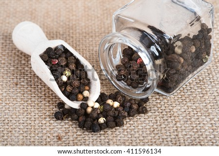 Wooden scoop with dried pepper berries - stock photo