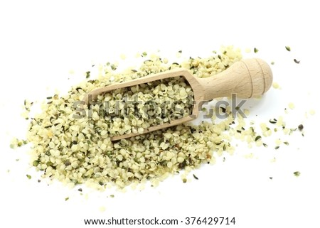 wooden scoop with hemp seeds isolated on white background - stock photo