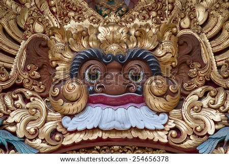 Wooden sculpture of the demon in the temple in Ubud, Bali, Indonesia - stock photo