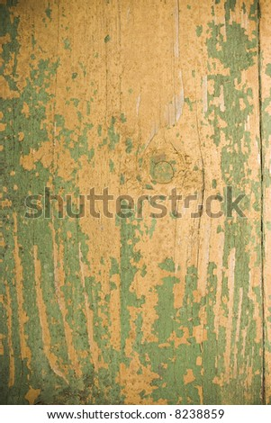 Wooden shabby plank with peeled paint - stock photo
