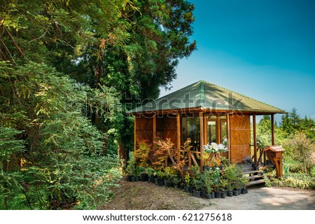 wooden shed house with flowers beds in botanical garden in batumi adjara georgia sunny