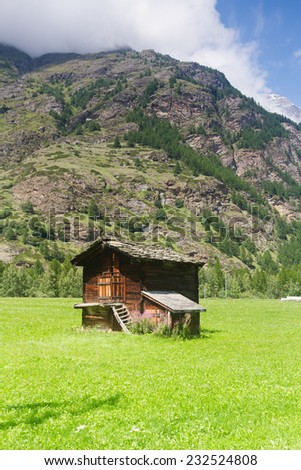 Wooden shed in the small mountain village in Swiss Alps. - stock photo