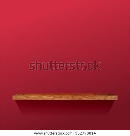 Wooden shelf on a red wall.