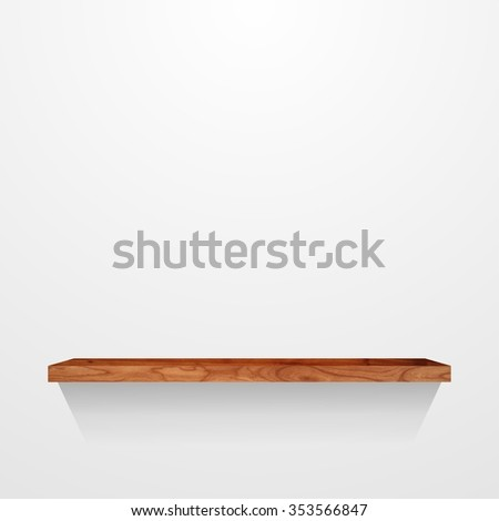 Wooden shelf on light grey wall background.
