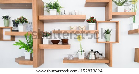 wooden shelf on wall and ceramics