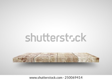 Wooden shelf on white background - stock photo