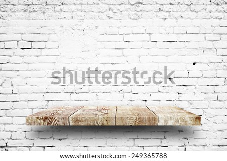 Wooden shelf white brick background - stock photo