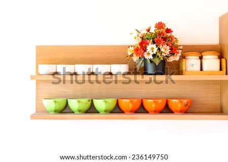 wooden shelf with cup of coffee on white background - stock photo