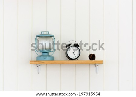 Wooden shelf with decoration objects - stock photo