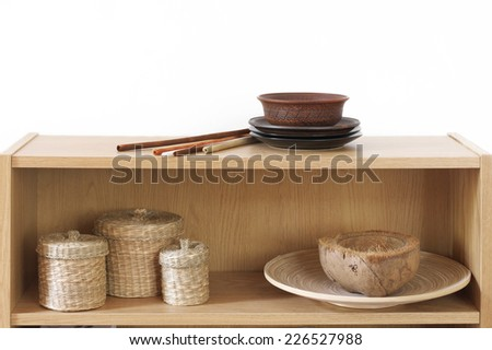 Wooden shelf with decorative elements on white background. - stock photo