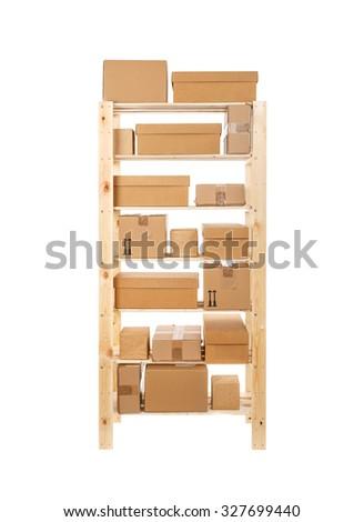Wooden shelves full of box - stock photo