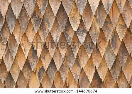 Wooden shingle roof. - stock photo