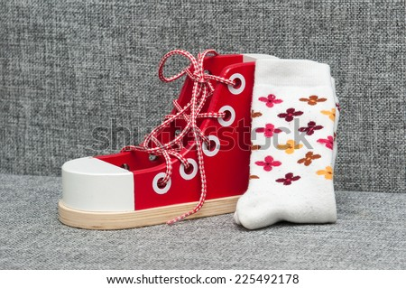 Wooden shoes with shoelace.learn to tie a shoelace. pair of socks with shoes - stock photo