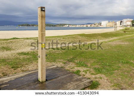 Wooden shower and watchtower on Compostela beach in Vilagarcia de Arousa