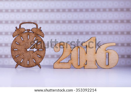 Wooden sign of alarm clock and inscription of 2016 year on lilac background. - stock photo