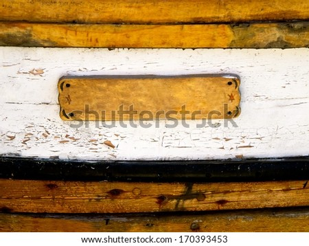 Wooden sign on an old fishing boat.
