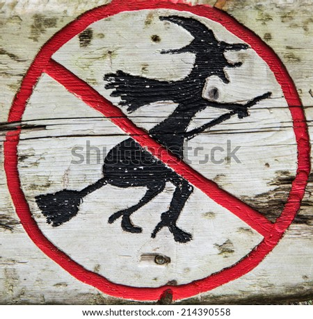 "Wooden sign ""Witch flights are forbidden"" in the forest near Bergen, Norway - Halloween background - stock photo"