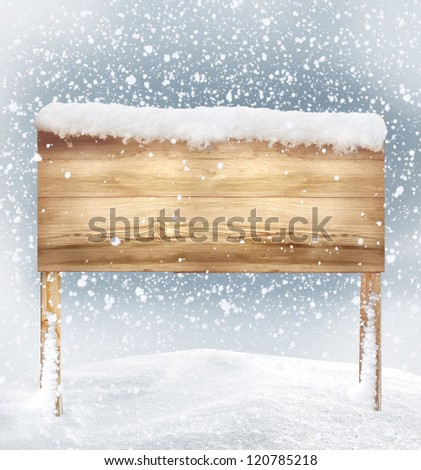 wooden signboard in snow - stock photo