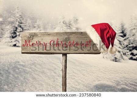 Wooden signboard in snowy winter landscape - stock photo