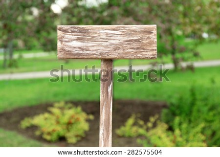Wooden signboard on nature background - stock photo