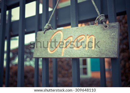 Wooden signboard with rope hanging on the  door open with text - Vintage Tone