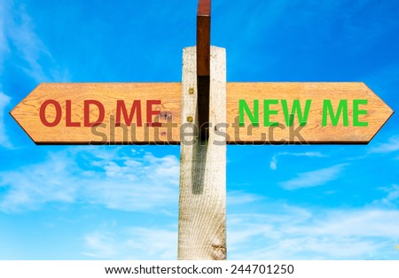 Wooden signpost with two opposite arrows over clear blue sky, Old Me and New Me, Life change conceptual image - stock photo